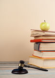 Stack of colorful real books, apple on yellow background, partial view. Back to school. Copy Space. Education background Stock Photos