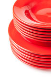 Stack of colorful red ceramics plates Royalty Free Stock Image