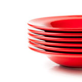 Stack of colorful red ceramics plates Royalty Free Stock Images