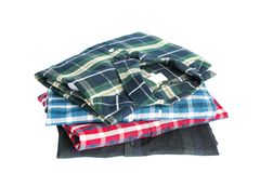 Stack of colorful shirts isolated royalty free stock photos
