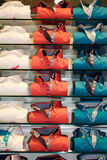 Stack of colorful shirts on the shelves Royalty Free Stock Photography