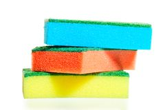 A stack of colorful sponges for ware on a white Stock Image