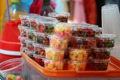 Stack of colorful sweetmeat in the plastic cup. Stack of colorful sweetmeat in the plastic cup for sale royalty free stock photography