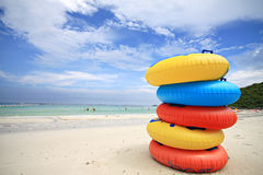Stack of colorful swimming rings. And blue sky background royalty free stock photos