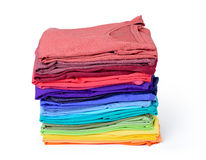 Stack of colorful t-shirt isolated on white background. File contains a path to isolation. Stock Photo