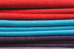 Stack of colorful t-shirts, close up Stock Images