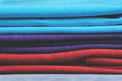 Stack of colorful t-shirts, close up Royalty Free Stock Photo