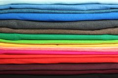 Stack of colorful t-shirts, close up. View Royalty Free Stock Image