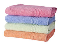 Stack of colorful terry towels isolated on white background Royalty Free Stock Photography