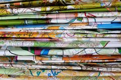 Stack of colorful topographic maps. For orienteering or rogaining sport as horizontal background. Concept of orenteering and rogaining Stock Image