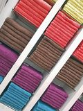 Stack of colorful towels - colorful background. Stack of colorful towels on the shelfs as Textile background for illustration Royalty Free Stock Images