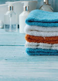 Stack of colorful towels and bath duck on the table Stock Photo