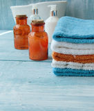 Stack of colorful towels and bath duck on the table Stock Images