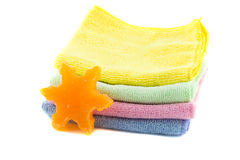 A stack of colorful towels and soap in the shape Royalty Free Stock Photos