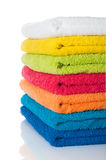 Stack of colorful towels on white. Stack of colorful towels on a white background royalty free stock photo