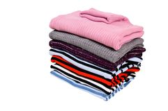 Stack of colorful winter sweaters  on a white. Stock Photography
