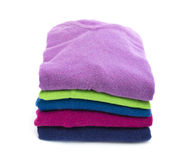Stack of colorful wool sweaters. Stack of colorful wool or cashmere sweaters isolated on white Royalty Free Stock Photography