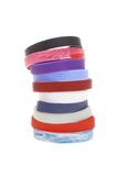 Stack of colorful wrist bands Royalty Free Stock Photos