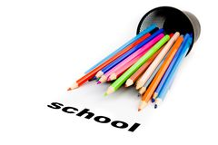 Stack of colour pencils near the word school Royalty Free Stock Photo