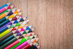Stack colour pencils on wooden background Stock Photos
