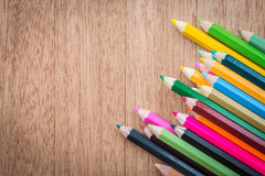 Stack colour pencils on wooden background. Close up stack colour pencils on wooden background stock photo