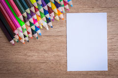 Stack colour pencils on wooden background Stock Images