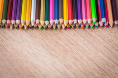 Stack colour pencils on wooden background. Close up stack colour pencils on wooden background royalty free stock image
