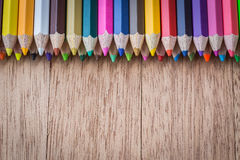 Stack colour pencils on wooden background. Close up stack colour pencils on wooden background stock image