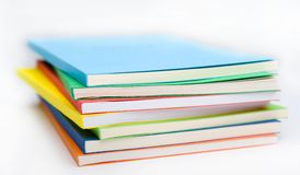 The stack of the coloured books. Stacked on each other seven books stock images