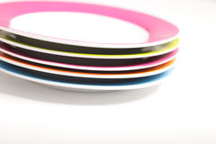 Stack of colourful plates Royalty Free Stock Photos
