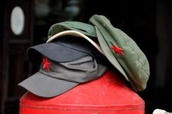 Stack of communist Maostyle caps with red star Stock Photo