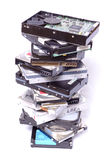 Stack Of Computer Hard Drives. Tall stack of assorted computer hard drives, on an isolated white background Royalty Free Stock Photo