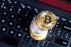 Stack of conceptual cryptocurrency bitcoin on computer keyboard Royalty Free Stock Image