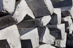Stack of concrete kerbs Stock Photo
