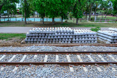 Stack of concrete railway sleepers near railroad.  Royalty Free Stock Photos