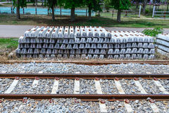 Stack of concrete railway sleepers near railroad Stock Photos