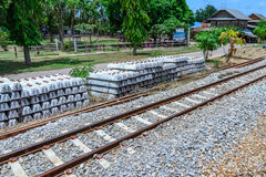 Stack of concrete railway sleepers near railroad.  Stock Photos