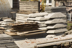 Stack of concrete slabs and metal sheets on the construction sit royalty free stock photos