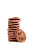 Stack of cookies. A stack of delicious, dark chocolate chip cookies with primary cookie.  Shot on a white background for user convenience Royalty Free Stock Image