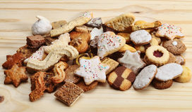 Stack of Cookies. Stack of various brown biscuits and cookies on a wooden table Stock Photo