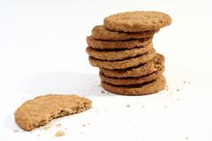 Stack of cookies. A view of a stack of hot, freshly baked, homemade cookies, right out of the oven and isolated on a white background.  One cookie is by itself Royalty Free Stock Photography