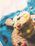 Stack of cookies with colorful candies. Vertical Royalty Free Stock Photos