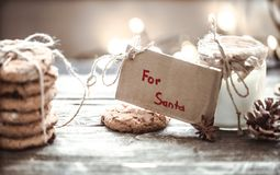 Milk and cookies for Santa. A stack of cookies and glass of milk for Santa on wooden background, concept Christmas and holiday Royalty Free Stock Photography