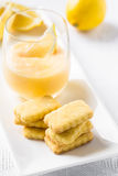 Stack of cookies and lemon curd in glass Stock Image