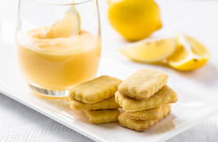 Stack of cookies and lemon curd in glass Royalty Free Stock Images