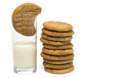 Stack of cookies beside milk Stock Images
