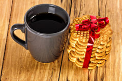 Stack of cookies tied with red ribbon and cup of coffee Stock Images