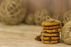 A stack of cookies tied with string. On a wooden table stock images