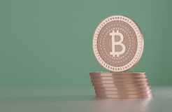 Stack of copper bitcoins as example for blockchain technology in front of blurry background.  stock photo