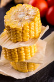 Stack of corn portions on slate stone Royalty Free Stock Photography